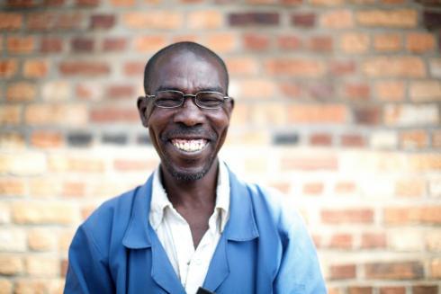 Rwandan man in reading glasses