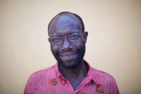Rwandan beneficiary in reading glasses