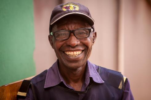 Rwanda beneficiary in reading glasses