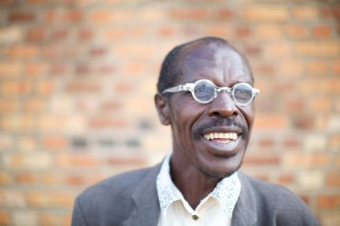 Rwandan beneficiary wearing adjustable glasses